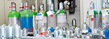 Gas cylinders in different sizes, silver green and blue coloured